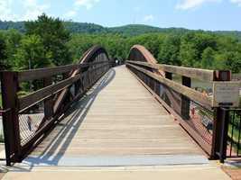The area features beautiful bridges that allow you to walk or bike across the Yough river.