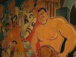 Famous old-school Pittsburgh sports figures like Bruno Sammartino, Mario Lemieux, Franco Harris and Terry Bradshaw are depicted on a mural at the Strip District restaurant.