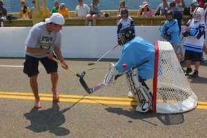 NHL Entry Draft top prospect Nail Yakupov, 18, of the Sarnia Sting plays some Dek Hockey on the Roberto Clemente Bridge.