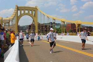 A hockey rink on the Roberto Clemente Bridge on one of the hottest days of the year so far!?