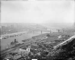 1903 - A look across the Monongahela River eastward toward the city of Pittsburgh, with Oakland in the far distance.