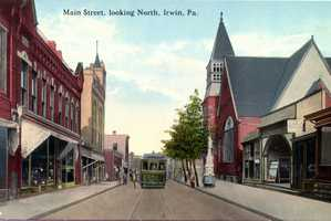 Main Street in Irwin, between 3rd and 4th Streets, looking North. Note the Wolf Statue fountain to the right side of this photo.