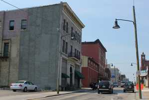 A similar look down Main Street, with several buildings now gone.