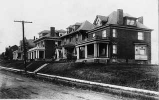 This picture was taken about 1910.  Pictured is the location of Washington Road at the corner of Academy Avenue. First a home, it later became a funeral home before the house was razed in the early 1970s.