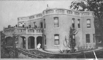 """It's hard to see the Smith """"Castle"""" from its location just off Cedar Boulevard. This photo was from about 1910. It was one of the first concrete, steel-reinforced houses in the country."""