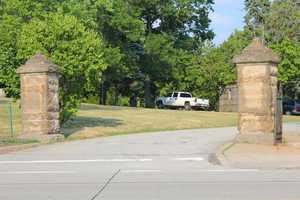 The same two stone markers remain standing at the gates to the entrance of the cemetery over 110 years later.