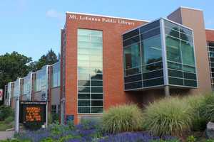 By the 1990s, the library's collection had outgrown the space and work began on a new facility. The new library, pictured here, opened June 21, 1997.