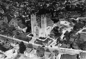 """For many years, Mt. Lebanon United Presbyterian Church was the only church in the area. The current """"Twin Towers"""" church was erected in 1929. This picture—probably taken in 1930, shows the two houses on either side of the church that served as parsonages. Both houses have been razed."""