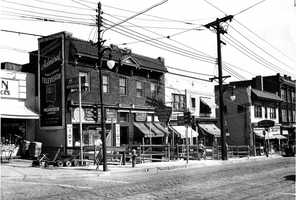 """A section of Washington Road between Alfred Street and Shady Drive East was widened at a cost of approximately $100,000. Five buildings on the east side of the street were rolled back ten feet, six inches to clear a traffic """"bottleneck."""" The road also had been widened in 1915."""