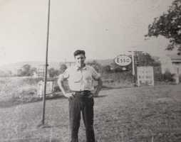 Pictured here is Ray Brown, standing in front of the Blue Ridge restaurant and gas station along Route 19. A water tower now stands in that area.