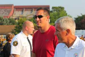 Retired Pittsburgh Steelers Aaron Smith (91) enters the stadium.  He was one of four former Steelers honored before Friday Night's practice.Did you take any photos at training camp? Share them with us by clicking here or e-mailing ulocal@wtae.com.  You can see viewer photos by clicking here.