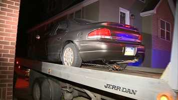 The car was towed away and the man was taken to jail.