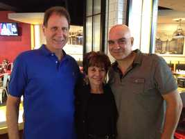 Michael Symon poses with his parents, Angel and Dennis, at the opening of Bar Symon at Pittsburgh International Airport.
