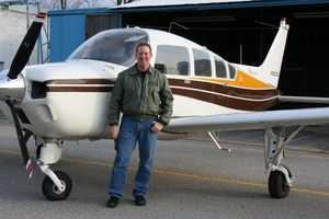 Brian Hall with his 1975 single-engine Beechcraft