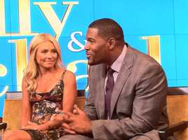 "Kelly Ripa and Michael Strahan on the set of ""Live! with Kelly and Michael."""