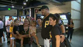 Demitrius Thorn poses with fans for a picture during Tuesday night's Pirates-Astros game at PNC Park