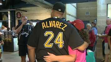 Demitrius Thorn takes a picture with a Pirates fan at PNC Park