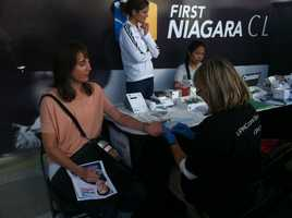 Dr. Mehmet Oz and UPMC health experts gave free 15-minute physicals at Consol Energy Center on Friday.