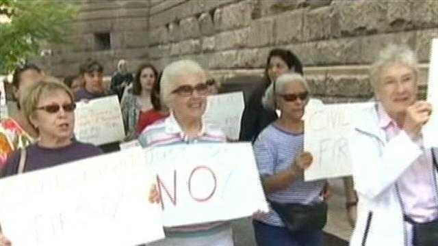 img-Pittsburghers rally while Pa. high court takes hard look at voter ID law