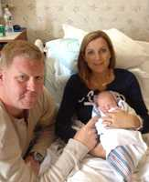Shannon Perrine with husband Ken and daughter Catherine Mary in her hospital room.