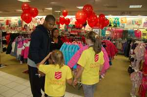 PITTSBURGH, PA - And the shopping begins.... The Steelers assisted by the staff at Macy's Ross Park Mall, assisted each child in finding the best clothing and the perfect size.