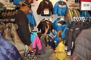 PITTSBURGH, PA - It's a big High Five with the children for finding some cool gear