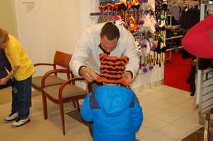 PITTSBURGH, PA - Charlie Batch finds the perfect hat and tries it out