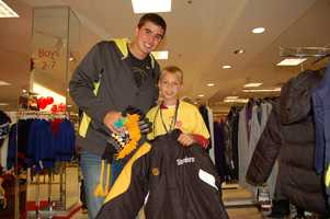 PITTSBURGH, PA - David Paulson and little shopping buddy pick out a Steelers Jacket