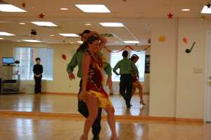 Cha Cha... Latin Music takes over! The costume adds more excitement to the room!