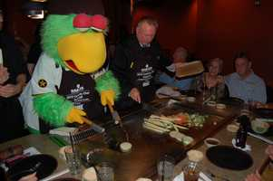 The Pittsburgh Pirates Parrot and his co-chef grilling up some veggies