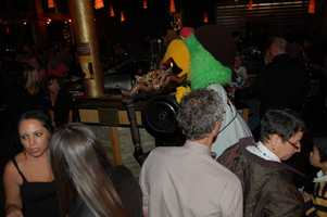 The Pittsburgh Pirates Mascot Parrot bangs the gong calling the dinner guests to their tables