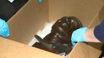 Heinz History Center employees open a box with Lynn Swann's Hall of Fame bust inside