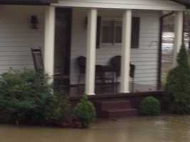 Patty Niswonger's yard was underwater in Latrobe and her neighbors needed a boat rescue from their homes.