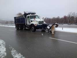 Trucks pulled to the side of the interstate as snow plows cleared a path.