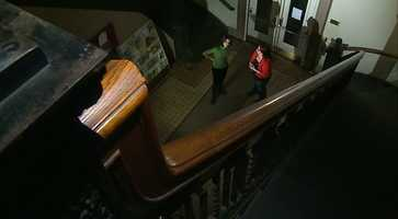 Library director Erin Tipping said some people have reported seeing a man at the top of the stairs in a blue outfit.