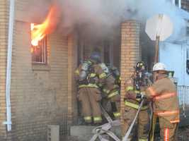 A house caught fire in an alley east of Water Street in Kittanning on Thursday morning.