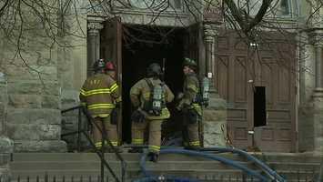 Firefighters had to break down the church's oak doors to get inside.