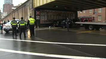 Pittsburgh police say the driver of a van was injured after crashing into a wall painted with a Pittsburgh Pirates mural in downtown.