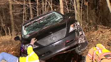 The black Lexus ended up on its side near the intersection of Logans Ferry and Hankey Church roads after the crash at about 12:40 a.m.