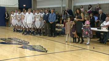 Sauer's wife, Amanda, and three daughters attended the ceremony.