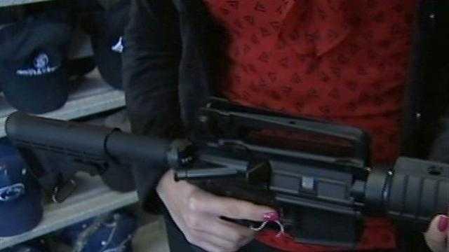 Ashlie Hardway holding gun