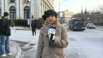 Amber Nicotra stays bundled up for her report in Oakland.