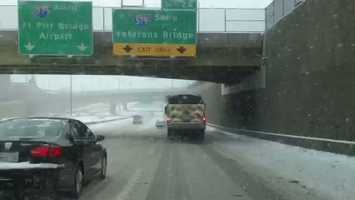 A truck spreads salt on Interstate 279 near downtown Pittsburgh.