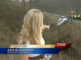 WTAE's Ashlie Hardway points to the area where a tow truck tried to pull the car out of the ravine and onto the road.