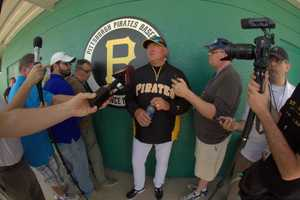 Pirates manager Clint Hurdle talks to reporters