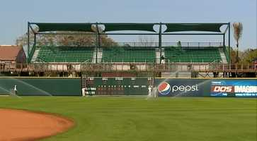 The left field bleachers seat 570 and are covered by awnings.