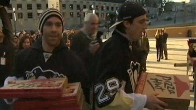Pascal Dupuis and Marc-Andre Fleury deliver pizza