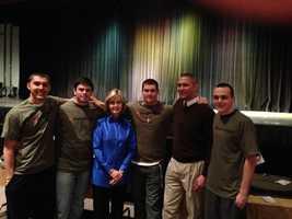 Plum High School Principal Ryan Kociela with WTAE's Sally Wiggin and Plum students.