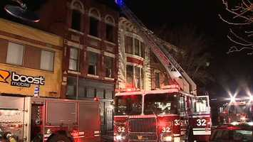 A three-story North Side building with businesses on the ground floor and apartments above caught fire late Thursday night.