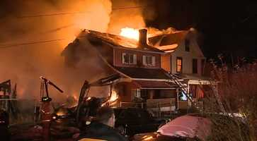 Fire destroyed a house and damaged three more in McKeesport early Tuesday morning.